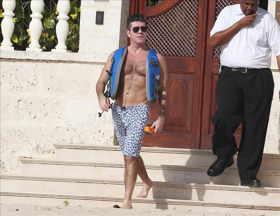 Simon Cowell is pictured exiting his villa in Barbados to board a jetride for his afternoon ride up the coast